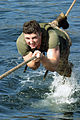 US Marine Corps Reserve (USMCR) Lance Corporal (LCPL) Elliot Danish, Rifleman, Kilo Company (K CO), 3rd Battalion, 25th Marines (3-25), pulls himself across a rope line over water as he finishes the cat crawl as 040130-M-UW798-043.jpg
