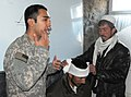 US Medic teaches Afghans how to treat a head wound -b.jpg