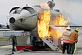 US Navy 040303-N-5821W-001 Personnel at NAS Sigonella's Fire Department battle a fire while training with the a Mobile Aircraft Fire Trainer (MAFT).jpg