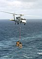 US Navy 040701-N-7408M-012 An MH-60S Knighthawk assigned to the Chargers of Helicopter Combat Support Squadron Six (HC-6) carries cargo between the fast combat support ship USS Detroit (AOE 4) and the nuclear-powered aircraft c.jpg