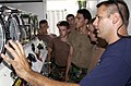 US Navy 040722-N-5526M-002 Naval Sea Cadets are briefed on the operation of a decompression chamber by instructor, Boatswain's Mate 1st Class Glenn Milisci.jpg