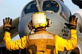 US Navy 041228-N-4757S-017 Aviation Boatswain's Mate 2nd Class Bradley Johnson directs an EA-6B Prowler.jpg
