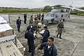 US Navy 050101-N-1229B-107 Sailors from USS Abraham Lincoln with the help of military members from Indonesia and Australia load a United States Navy Seahawk helicopter with supplies to be distributed throughout the island.jpg