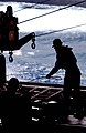 US Navy 050312-N-6781S-007 During a Vertical Replenishment (VERTREP), crew members aboard USS Nimitz (CVN 68) transfer weapons and supplies from the Military Sealift Command (MSC) fast combat support ship USNS Bridge (T-AOE 10).jpg