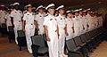 US Navy 050623-N-2000D-013 Fifty-nine officer candidates stand at attention during the Seaman to Admiral (STA 21) Naval Science Institute (NSI) program graduation ceremony at Naval Base Newport.jpg