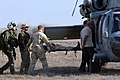 US Navy 051130-N-6901L-089 Sailors and air crewmen assigned to Helicopter Sea Combat Squadron Two One (HSC-21), load a training mannequin simulating an injured soldier.jpg