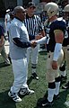 US Navy 060909-N-1134L-011 Entertainer Bill Cosby shakes hands with Navy linebacker Rob Caldwell prior to the start of the U.S. Naval Academy football game against the University of Massachusetts.jpg