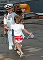 US Navy 070629-N-2970T-003 Two young girls welcome home their father as he returns home from deployment.jpg