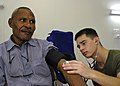 US Navy 070808-N-4954I-041 Hospital Corpsman 3rd Class Phil Garber checks the blood pressure of a local resident at Modilon General Hospital in support of Pacific Partnership.jpg