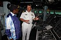 US Navy 071021-N-4014G-083 Cmdr. Robert Hall Jr., commanding officer of guided-missile destroyer USS Porter (DDG 78), shows the ship's bridge to the Honorable Suleiman R. Shakombo, Minister of State for National Heritage, Kenya.jpg