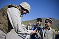 US Navy 071126-N-5549O-098 Secretary of the Navy (SECNAV), Donald C. Winter, gives pens to the local children as he takes a tour of the site for the Kunar Trade School construction project.jpg
