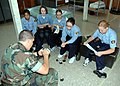 US Navy 080817-N-2296G-028 U.S. Naval Sea Cadet Josh Gladden provides instruction on how to get the perfect spit-shined shoes as part of basic training to U.S. Naval League Cadet Corps recruits during their one-week boot camp.jpg