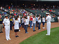 US Navy 090620-N-2888Q-031 Cmdr. Mike Mullins, right, commander, Navy Recruiting District Dallas, administers the Oath of Enlistment to 10 Delayed Entry Program members at the Bricktown Ballpark in Oklahoma City.jpg