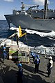 US Navy 090718-N-9123L-160 Sailors aboard guided-missile destroyer USS McCampbell (DDG 85) secure pallets of stores from the Military Sealift Command dry cargo-ammunition ship USNS Amelia Earhart (T-AKE 6) during an underway re.jpg
