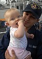 US Navy 091203-N-2456S-054 Gas Turbine System Technician (Mechanical) Fireman Christian Harvey holds his nine-month old daughter.jpg