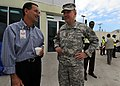 US Navy 100219-N-5961C-008 Art Torno, left, American Airlines Regional Director for the Caribbean, speaks with Gen. Ken Keene, commanding general of Operation Unified Response, at Toussaint Louverture International Airport in.jpg