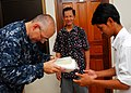 US Navy 100623-N-4044H-209 Lt. Derrick Horne, a Navy chaplain embarked aboard the Military Sealift Command hospital ship USNS Mercy (T-AH 19), gives a hygiene kit, assembled by Latter-day Saint Charities, to a shelter member du.jpg