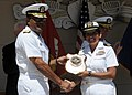 US Navy 100716-N-0569T-095 Vice Adm. D.C. Curtis presents Lt. Sophia Haberman with a plaque for her work with the Surface Warfare Officer Introduction Course.jpg