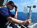 US Navy 100924-N-7948R-002 Lt. j.g Elizabeth Adkins uses an anemometer to check the wind speed and direction aboard the amphibious dock landing shi.jpg
