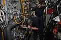 US Navy 101107-N-7293M-241 Machinist's Mate 3rd Class Shawn Stevens watches as Machinist's Mate Fireman Lucas Torres uses a furnace inspection devi.jpg