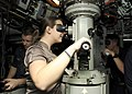US Navy 101119-N-3560G-001 The spouse of Lt. j.g. John Russell looks through the periscope aboard the attack submarine USS Cheyenne (SSN 773) durin.jpg