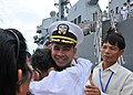 US Navy 101203-N-8721D-026 Cmdr. Michael V. Misiewicz, commanding officer of the guided-missile destroyer USS Mustin (DDG 89), is greeted by member.jpg