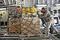 US Navy 110312-F-MG591-054 Airmen assigned to the 89th Aerial Port Squadron load pallets onto a U.S. Air Force C-17 Globemaster III transport aircr.jpg
