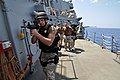 US Navy 110414-N-7293M-413 Operations Specialist 3rd Class David Wolery, assigned to the visit board, search and seizure (VBSS) team from the amphi.jpg