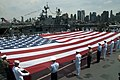 US Navy 110530-N-1251W-103 Service members unfurl an American Flag on the flight deck of the Intrepid Sea, Air ^ Space Museum during a Fleet Week N.jpg