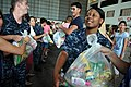 US Navy 111023-N-WW409-821 Operations Specialist Seaman Kristine Thompson, assigned to the guided-missile destroyer USS Mustin (DDG 89), volunteers.jpg