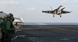 US Navy 120112-N-OY799-298 An F-A-18F Super Hornet from the Black Aces of Strike Fighter Squadron (VFA) 41 lands on the flight deck of the Nimitz-c.jpg