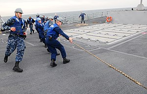 US Navy 120213-N-SK590-177 Sailors heave around a line during a replenishment at sea aboard the Arleigh Burke-class guided-missile destroyer USS St.jpg