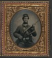 Unidentified soldier in Union uniform with eagle breast plate, cartridge box, and cap box holding musket with bayonet in scabbard LOC 5228565097.jpg
