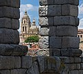 View of the Cathedral through the arches of the Aqueduct. Segovia, Spain.jpg