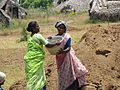 Villagers building a water storage pond 2 (2508319910).jpg