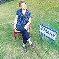 Walker Lukens sitting with his 'Make America Lifted Again' sign for promotion of his Never Understood EP..jpg