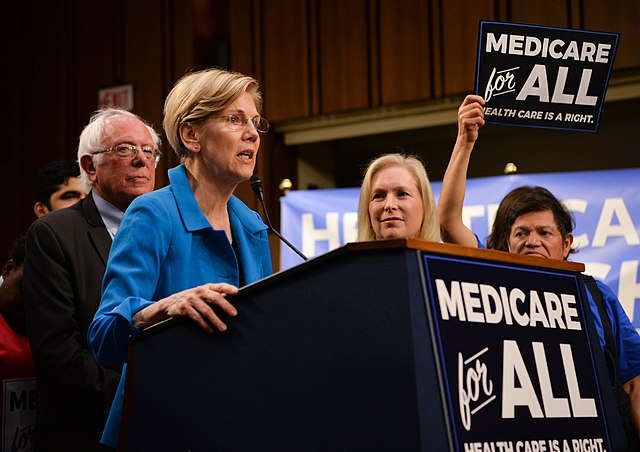 Elizabeth Warren and Bernie Sanders campaigning for extended US medicare coverage in 2017.