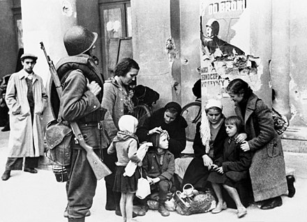 Warsaw 1939 refugees and soldier Warsaw 1939 refugees and soldier.jpg