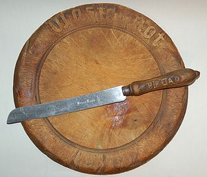 Bread knife - 19th century cutting board with a bread knife