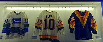 Pavel Bure - Bure's first game-worn Canucks jersey (centre) on display at Rogers Arena (also pictured on either side are Wayne Maki and Glen Hanlon's jerseys).