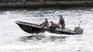 Royal Marines in a Rigid Raider assault waterc...