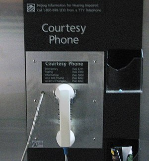 Courtesy telephone - A white courtesy telephone