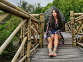 Woman on bridge in mangrove forest.png