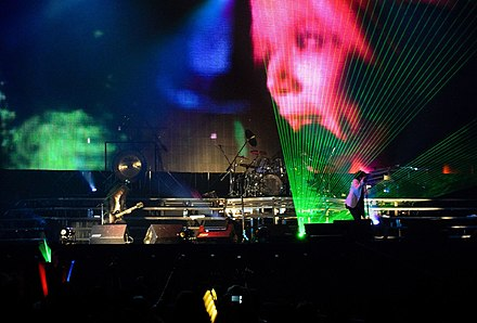 X Japan in concert in Hong Kong 2009, featuring an image of the deceased hide on screen, whom they still consider a member of the band. Xjapan hongkong2.jpg
