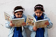 Young girls reading - Government primary school in Amman, Jordan