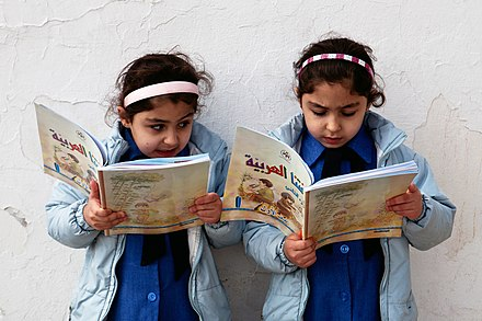 Jordanian school girls pictured reading in a public school. Jordan's total youth female literacy rate (15 - 24 years) was 99.37% in 2015. Young girls reading - Government primary school in Amman, Jordan.jpg
