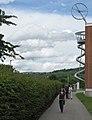 Álvaro-Siza-Promenade mit Vitra Rutschturm in Weil am Rhein, am Horizont der Blauen.jpg