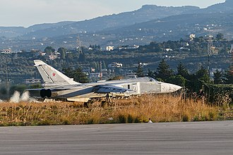 Russian military intervention in the Syrian Civil War - A Russian Su-24 jet aircraft in Latakia, government-held Latakia Governorate.