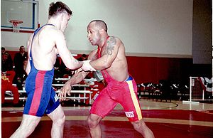 John Roy is in full guard against his opponent