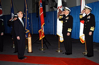 Civilian control of the military - Admiral John B. Nathman (far right) and Admiral William J. Fallon salute during honors arrival of Secretary of the Navy Gordon R. England at a change of command ceremony in 2005. A subordinate of the civilian Secretary of Defense, the Secretary of the Navy is the civilian Head of the Department of the Navy, which includes the U.S. Navy and the Marine Corps.